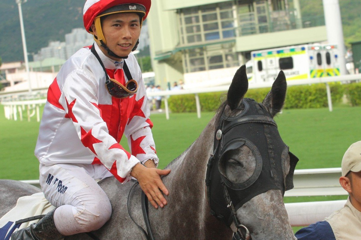 Matthew Poon gives Hard Ball Get a pat after notching his 20th winner in Hong Kong. Photos: Kenneth Chan
