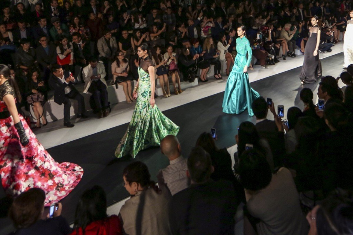 Models on the catwalk during Shanghai Tang's 20th anniversary celebration in Shanghai presenting it's spring/summer 2015 collection