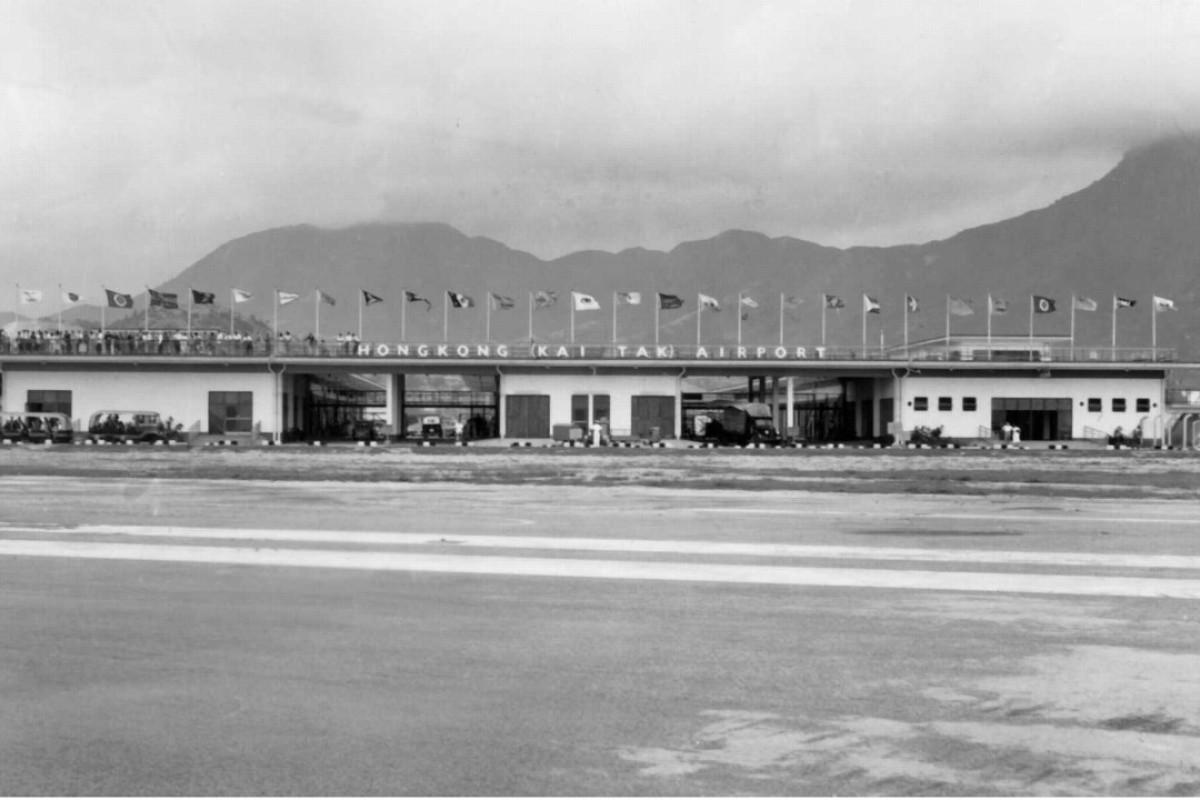 Hong Kong's Kai Tak Airport in the late 1950s was a low-rise affair, like the buildings around it.
