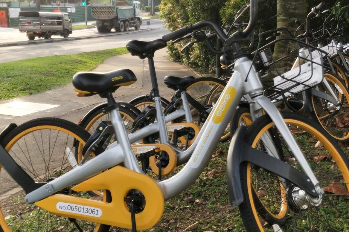 Tiny Singapore bikes sit waiting to be picked up by riders. Photo: Handout