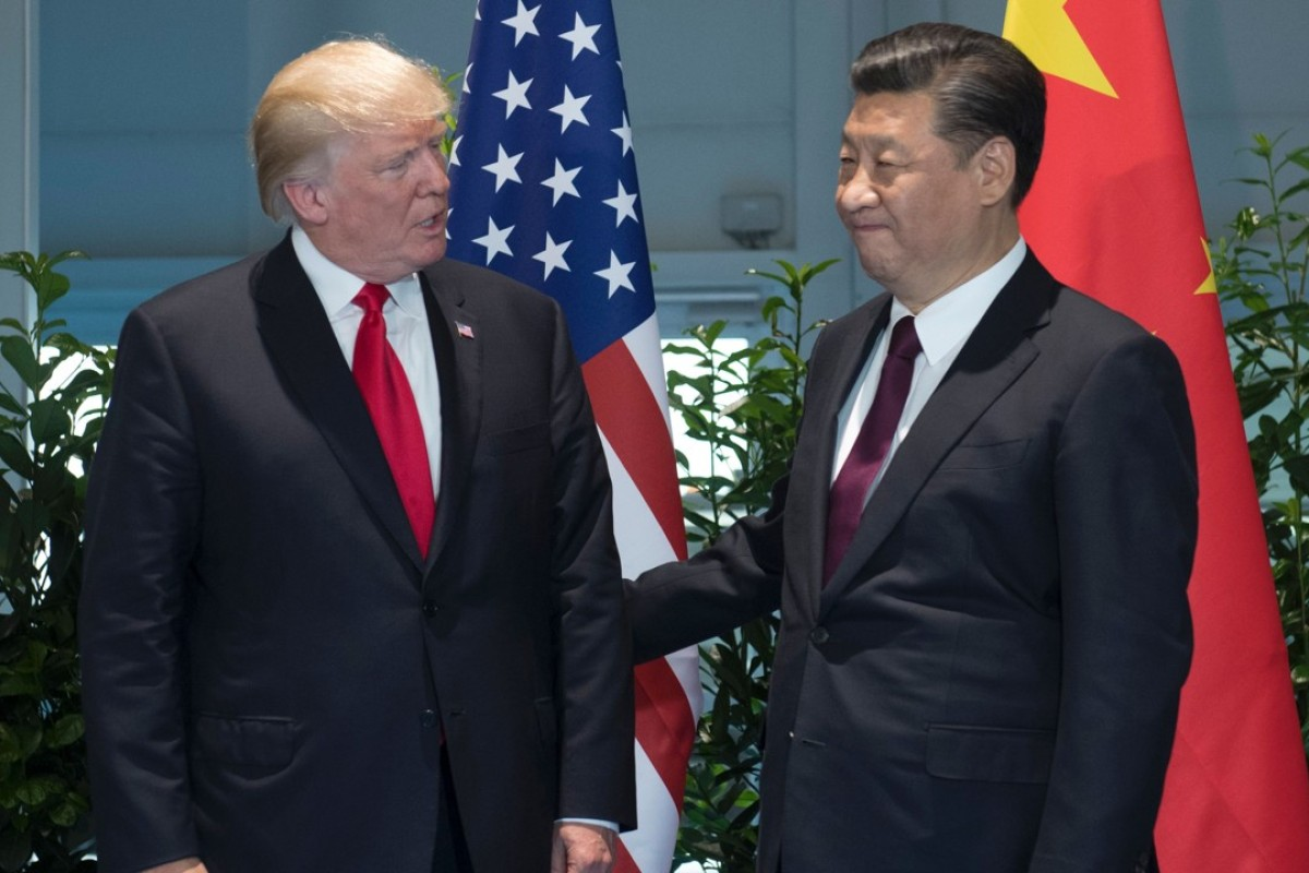 Us president donald trump and chinese president xi jinping pose prior to a meeting on the