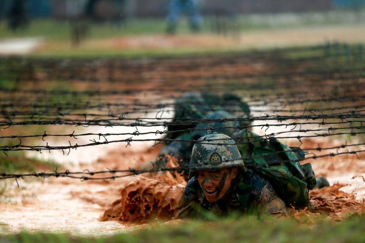 Soldiers of the People's Liberation Army Marine Corps train in Zhanjiang, Guangdong province. Photo: Reuters