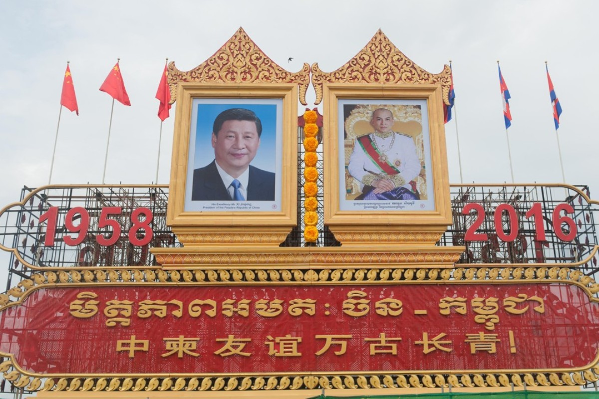 Portraits of Chinese President Xi Jinping and Cambodian King Norodom Sihamoni in Phnom Penh, during Xi's visit in 2016. Picture: Alamy