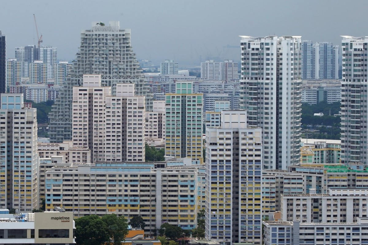 Private residential apartments and public housing estates in Singapore. Increasingly, Chinese firms are outbidding local firms for new property projects in the Lion City. Photo: Reuters