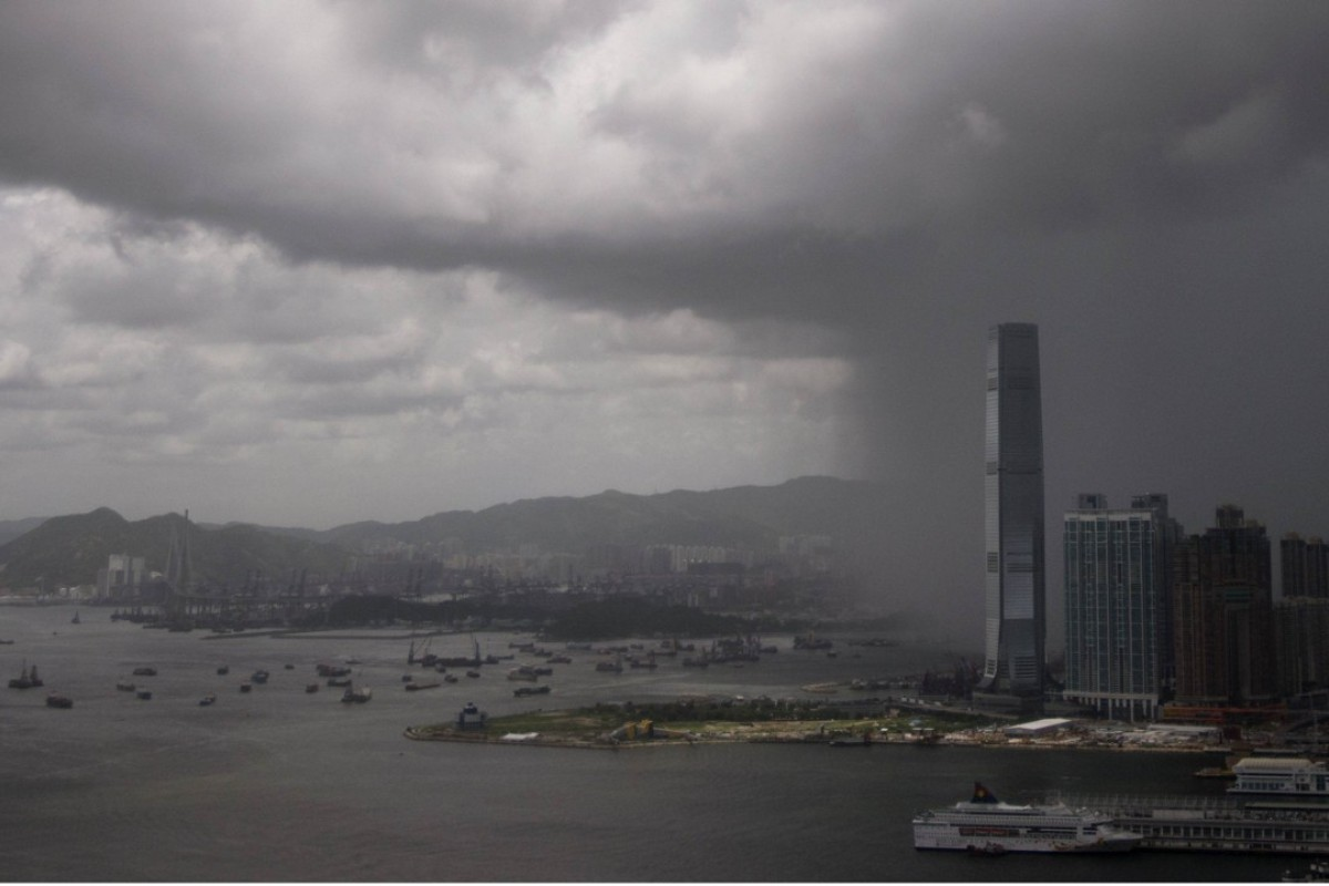 Rain clouds approach the International Commerce Centre (ICC) in Hong Kong. Photo: AFP