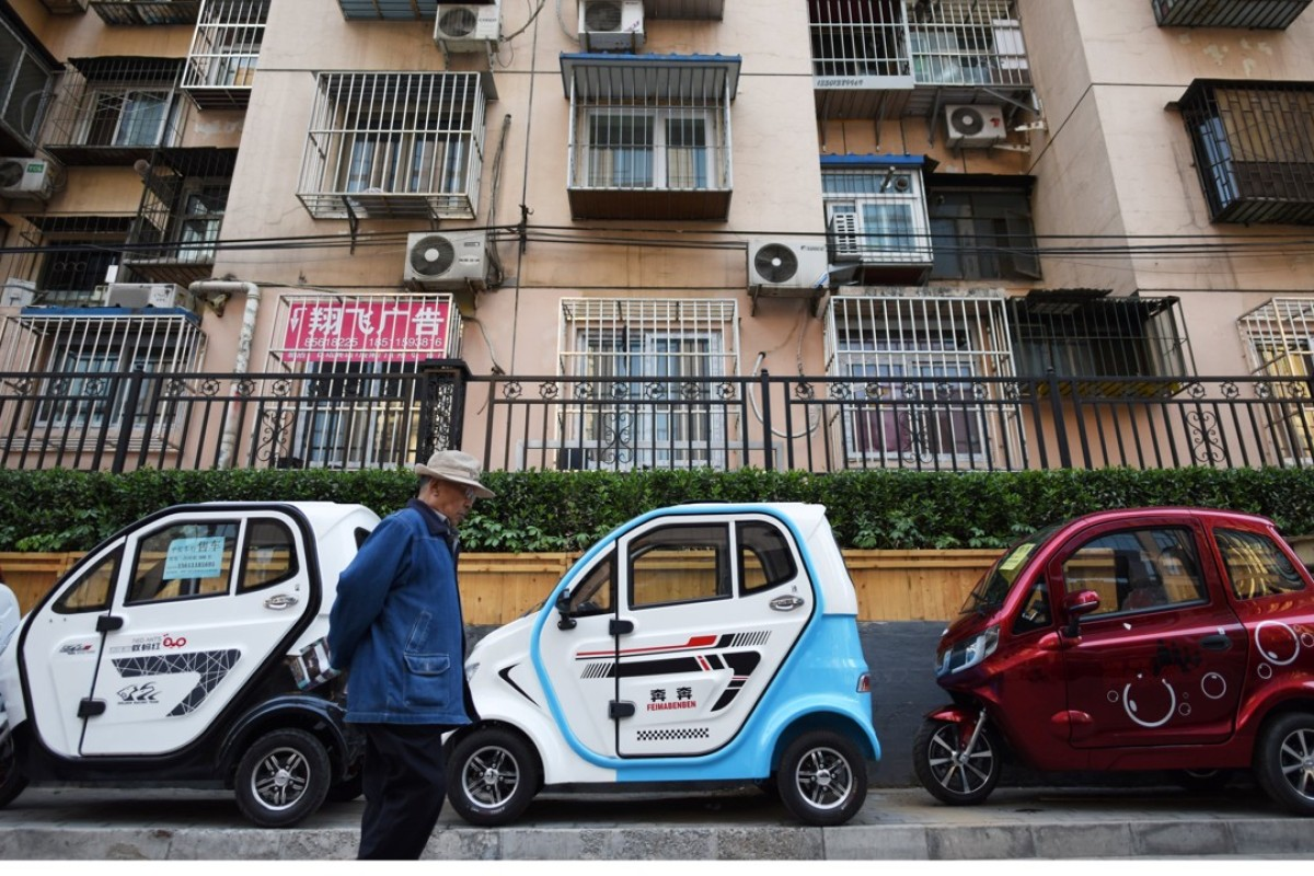 Electric vehicles on a sidewalk in Beijing. Photo: AFP