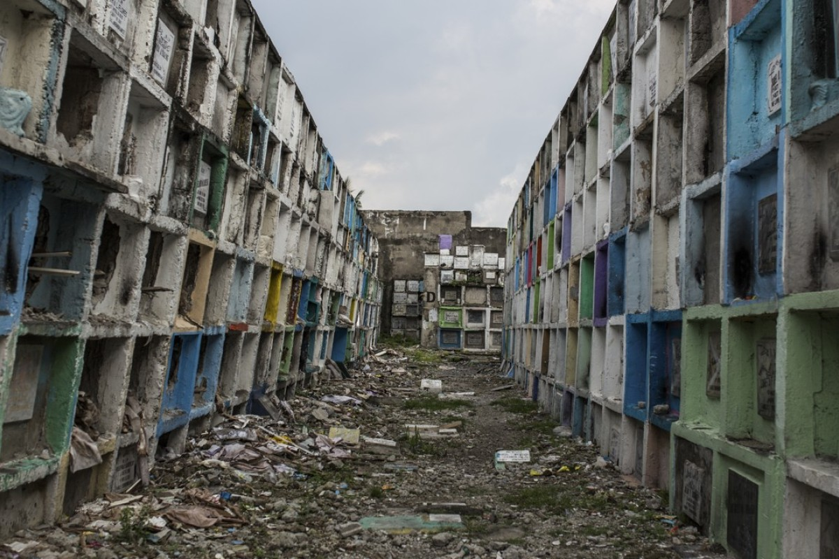 Apartment tombs in Navotas Public Cemetery  Pictures Paul Ratje Manila s apartment where the poor bury their dead until