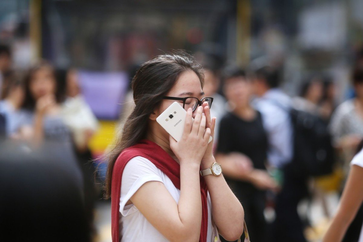A woman covers her nose at a crossing in Causeway Bay, one of the most polluted areas in Hong Kong. Picture: SCMP