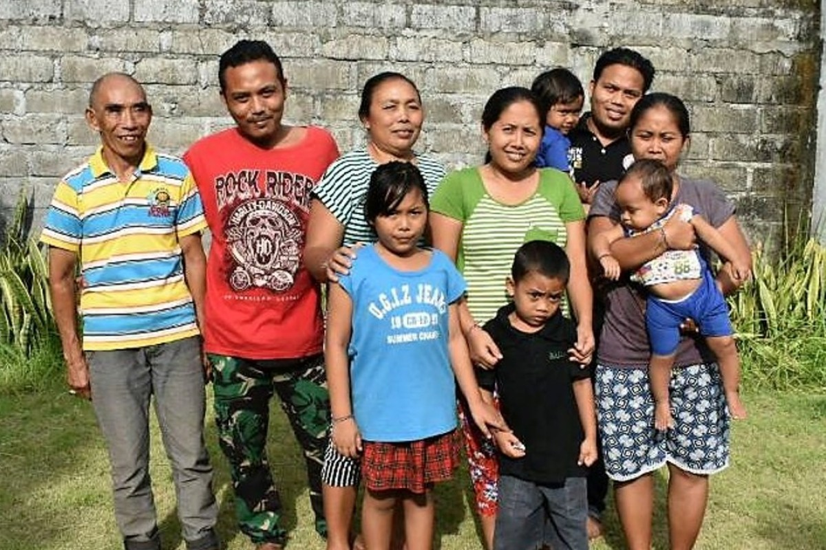 Nyoman Gerti, third from left, 52, and her family have found refuge in Gianyar, approximately 62km from Mount Agung in Bali, Indonesia. Photo: Karim Raslan