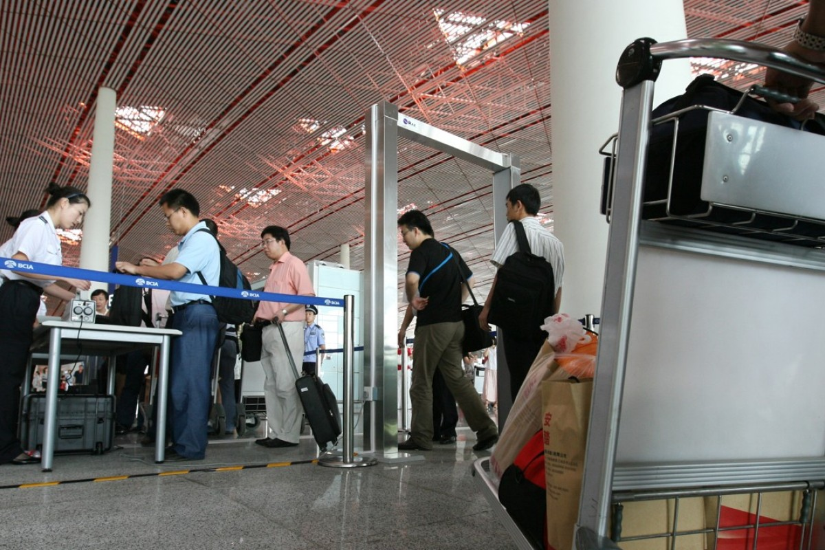 Passengers wait in lines to pass through customs of Beijing's International Airport. Some travellers from China are downloading VPN apps while overseas that allow them unfiltered access to the internet. Handout photo