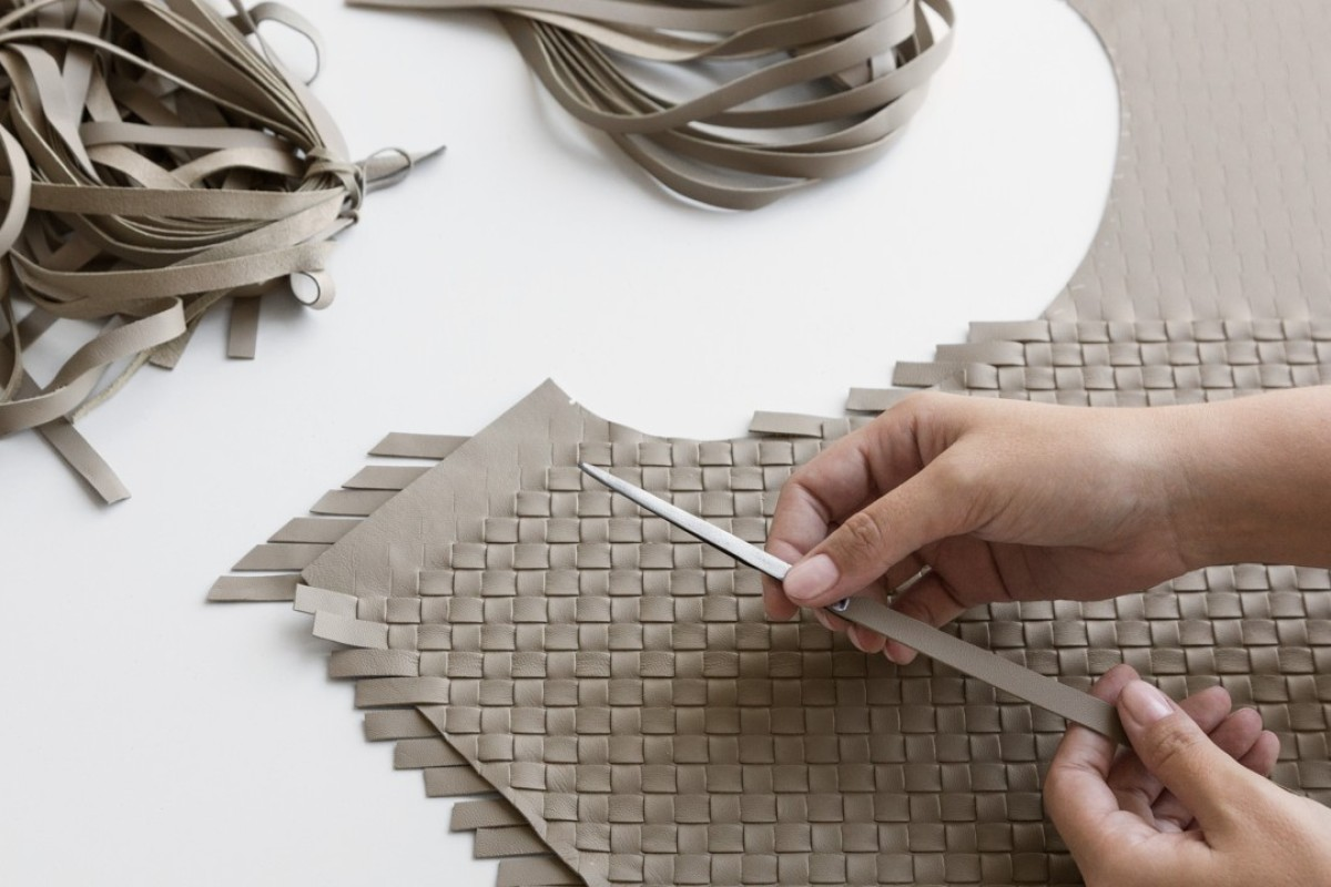 The making of Bottega Veneta's Veneta bag using the 'intrecciato' technique.