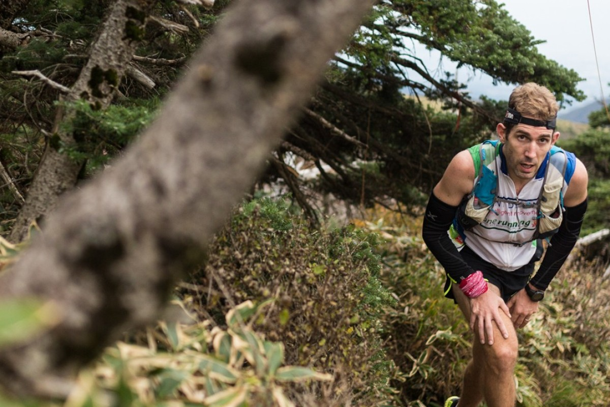 Baptiste Puyou runs in the TransJeju 100km in Korea on his way to victory. Photos: Guillem Casanova