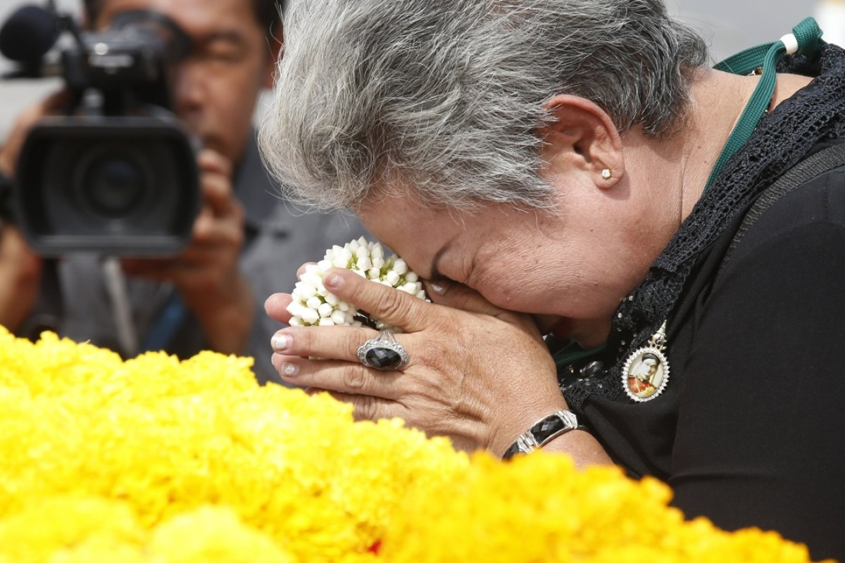 A Thai mourner pay respects to the late Thai King Bhumibol Adulyadej. Photo: EPA