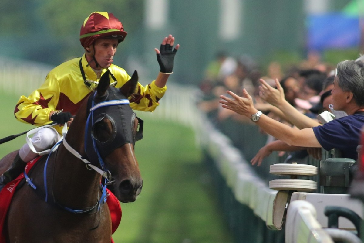 Nash Rawiller gives a fan a high-five after Southern Legend's win at Happy Valley on Sunday. Photos: Kenneth Chan