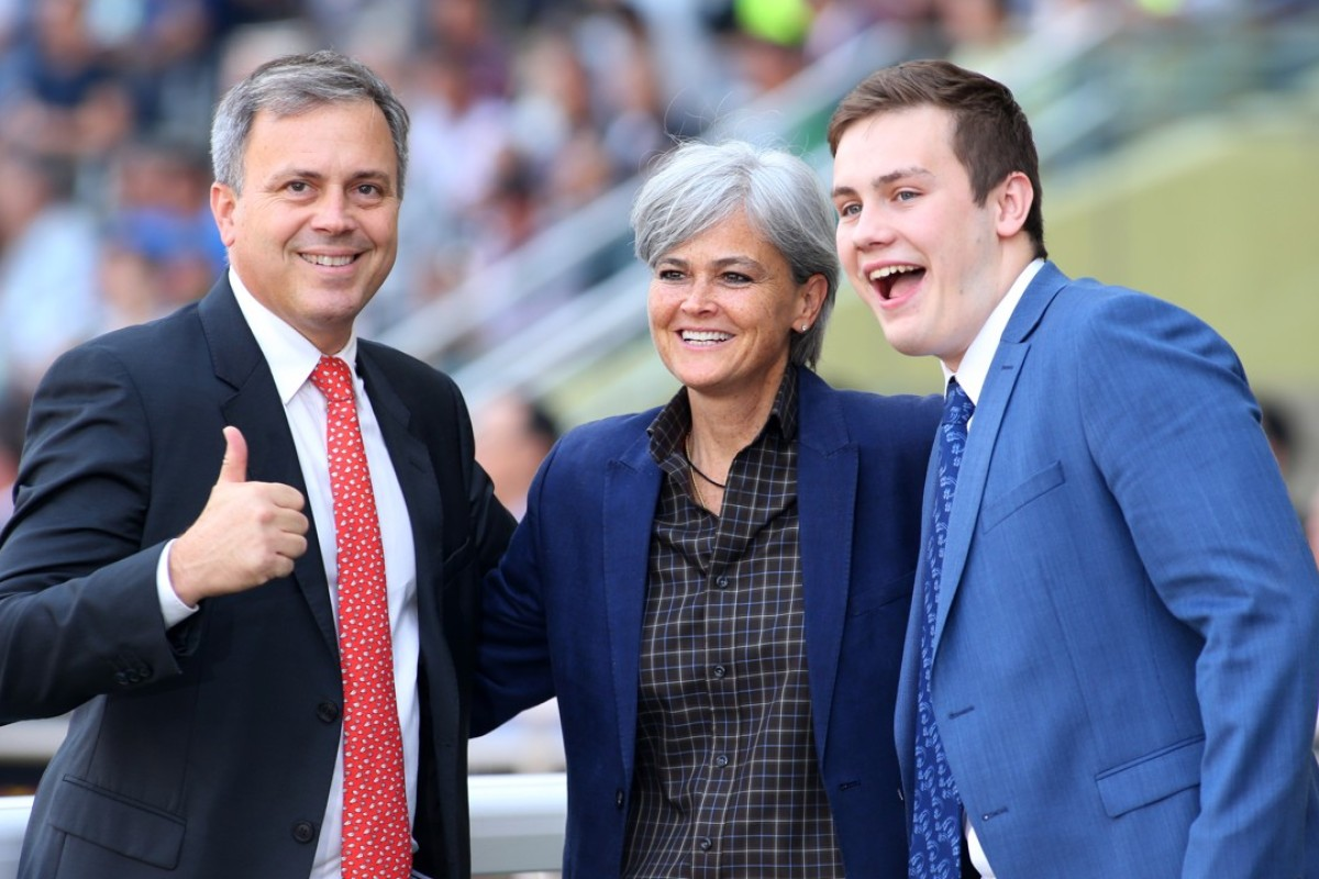 Trainer Caspar Fownes, his sister Fenella and son Ryan pose for the cameras after another win at Happy Valley on Sunday. Photos: Kenneth Chan
