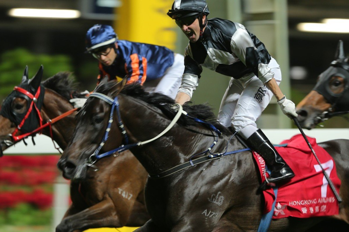 Neil Callan celebrates Top Laurel's win at Happy Valley on Wednesday night. Photos: Kenneth Chan