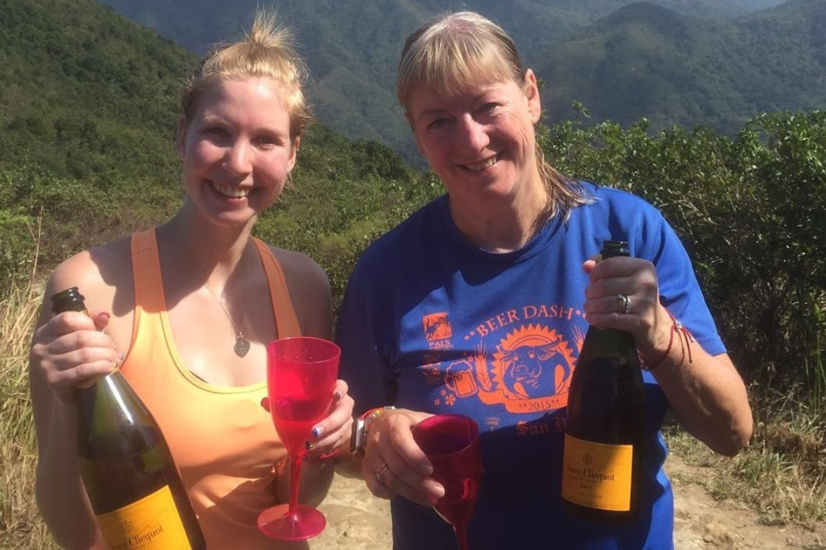 Sarah Allen and Carol keen await the leaders and drink champagne on stage three of the Oxfam Trailwalker. Photos: Mark Agnew
