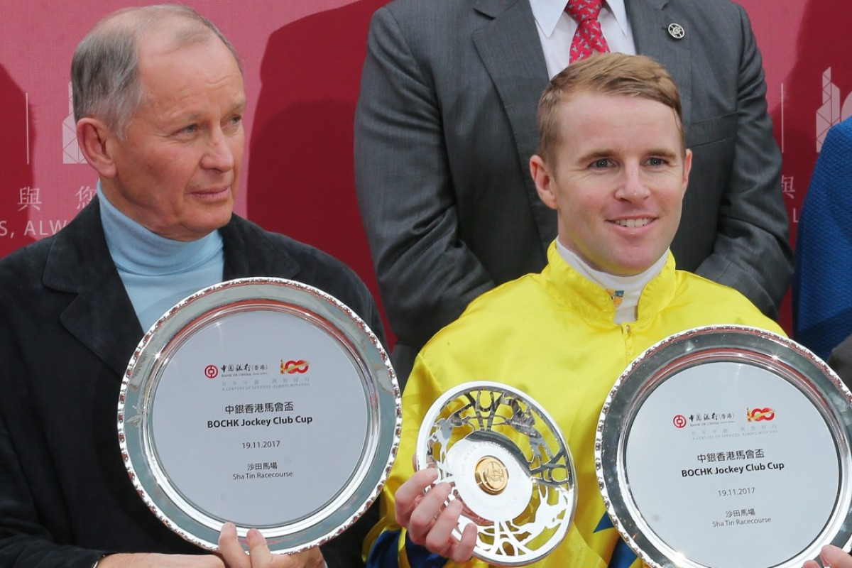 John Moore and Tommy Berry pose with their trophies after winning the Jockey Club Cup with Werther. Photos: Kenneth Chan