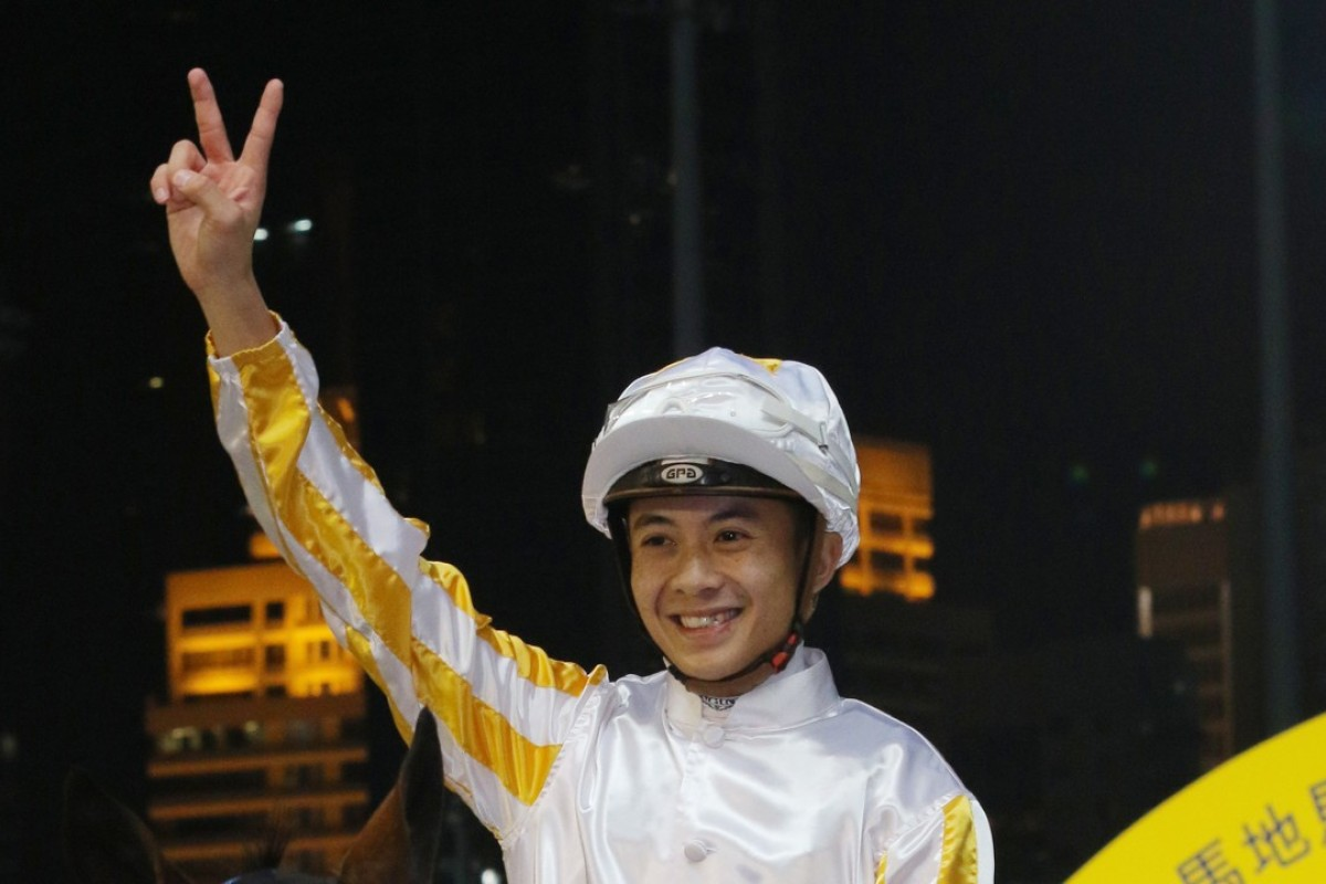 Derek Leung celebrates a winning double at Happy Valley on Wednesday night after winning aboard Magnetism. Photo: Kenneth Chan
