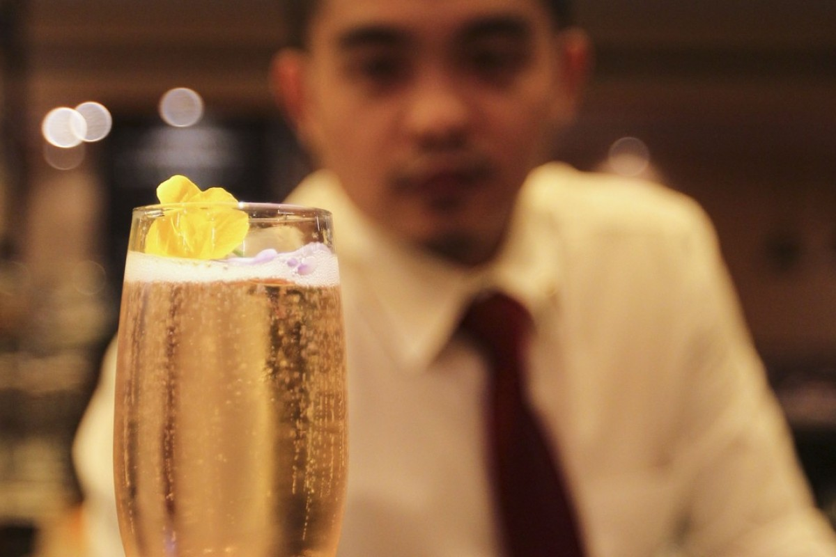 John Paolo Escolano, the bar supervisor at Terroir Parisien, in Central, with a kir royale cocktail. Picture: Roy Issa