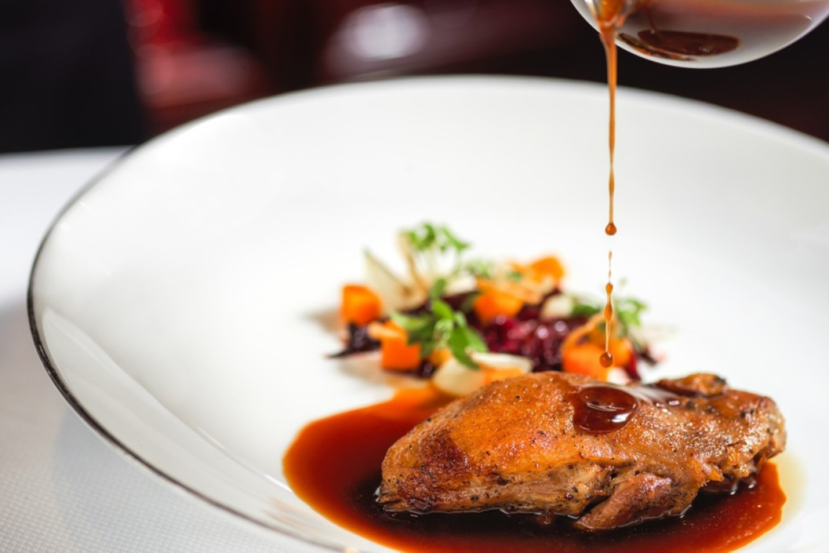 The slow-cooked Silver Hill Duck confit with braised radicchio, white onion puree, pickled pumpkin and orange jus.