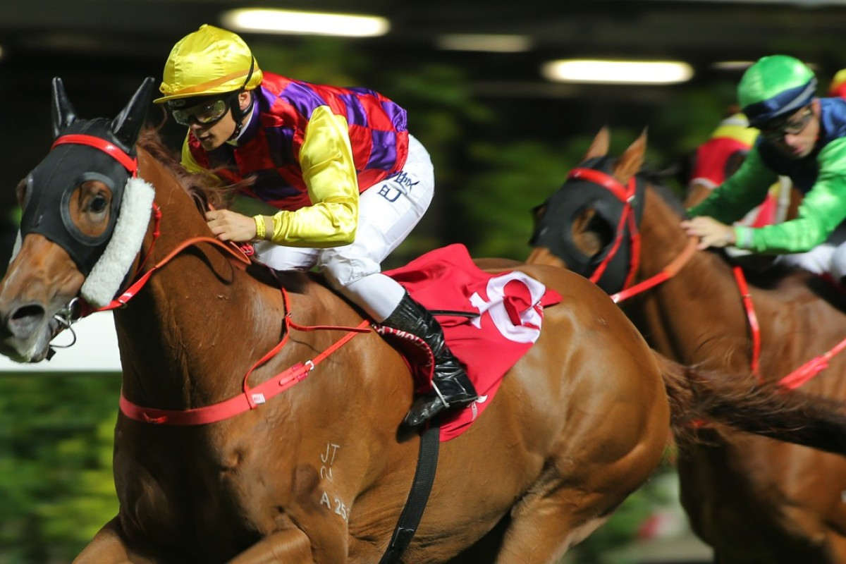 Alex Badel guides Winning Faith to victory at Happy Valley. Photos: Kenneth Chan