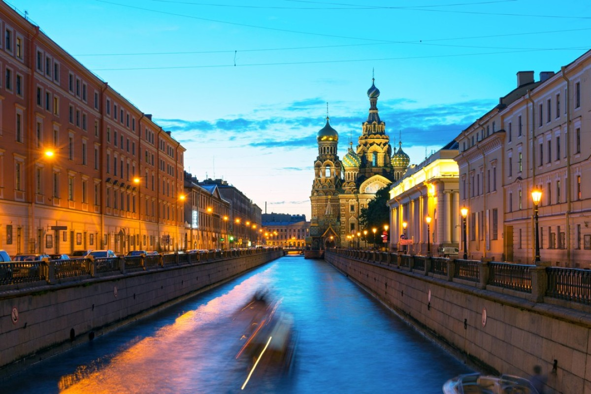 Tourist boats sail to the Church of Savior on Spilled Blood at White Night in St Petersburg, Russia. This is an architectural landmark of central St Petersburg, and a unique monument to Alexander II. Photo: Shutterstock