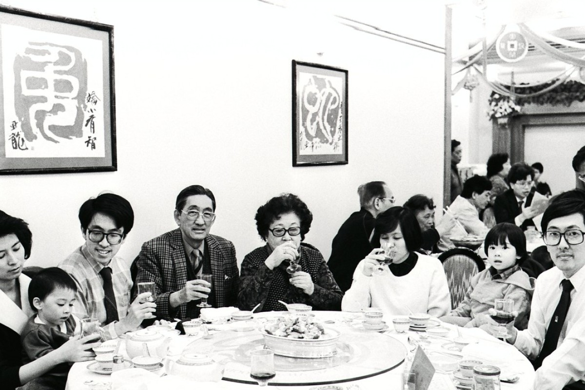 Three generations of a Hong Kong family gather for a meal to celebrate the winter solstice in 1988.