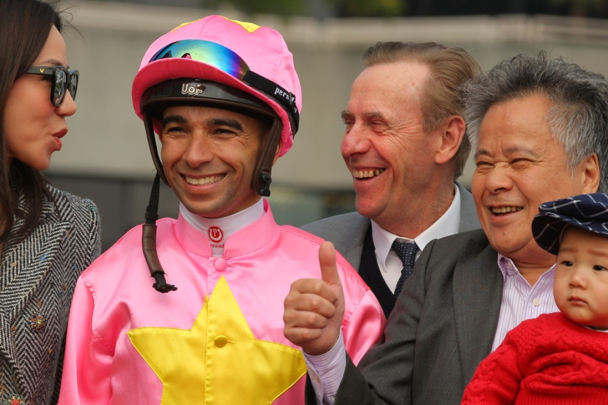Joao Moreira and John Size share in the celebrations with the connections of Unicron Jewellery. Photos: Kenneth Chan