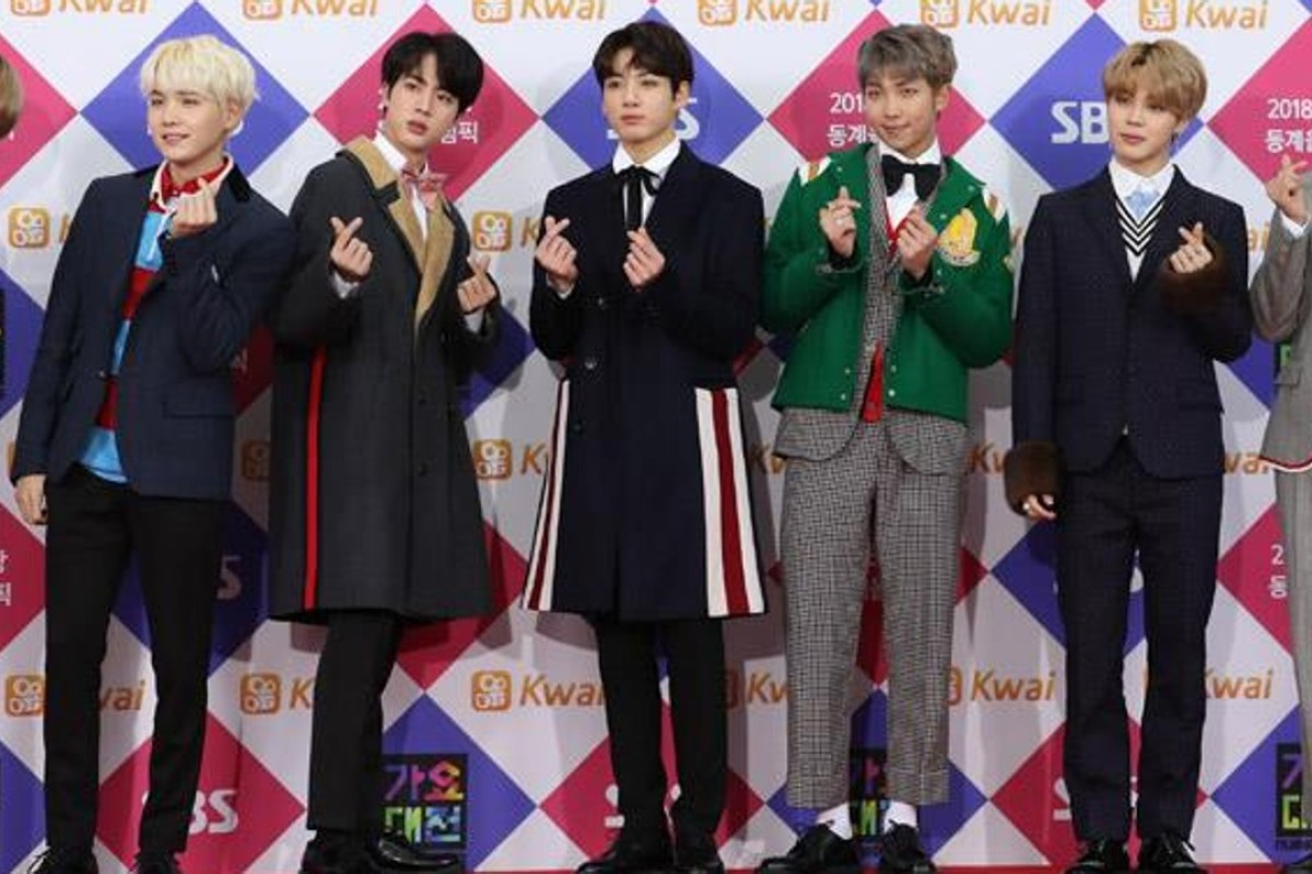 Members of K-pop boy band BTS pose during an SBS year-end programme at Gocheok Sky Dome in Seoul. The band has broken into the US Top 40 with the track 'MIC Drop'. Photo: Yonhap