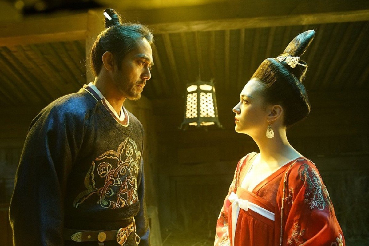 Hiroshi Abe (left) and Sandrine Pinna in a scene from Legend of the Demon Cat.