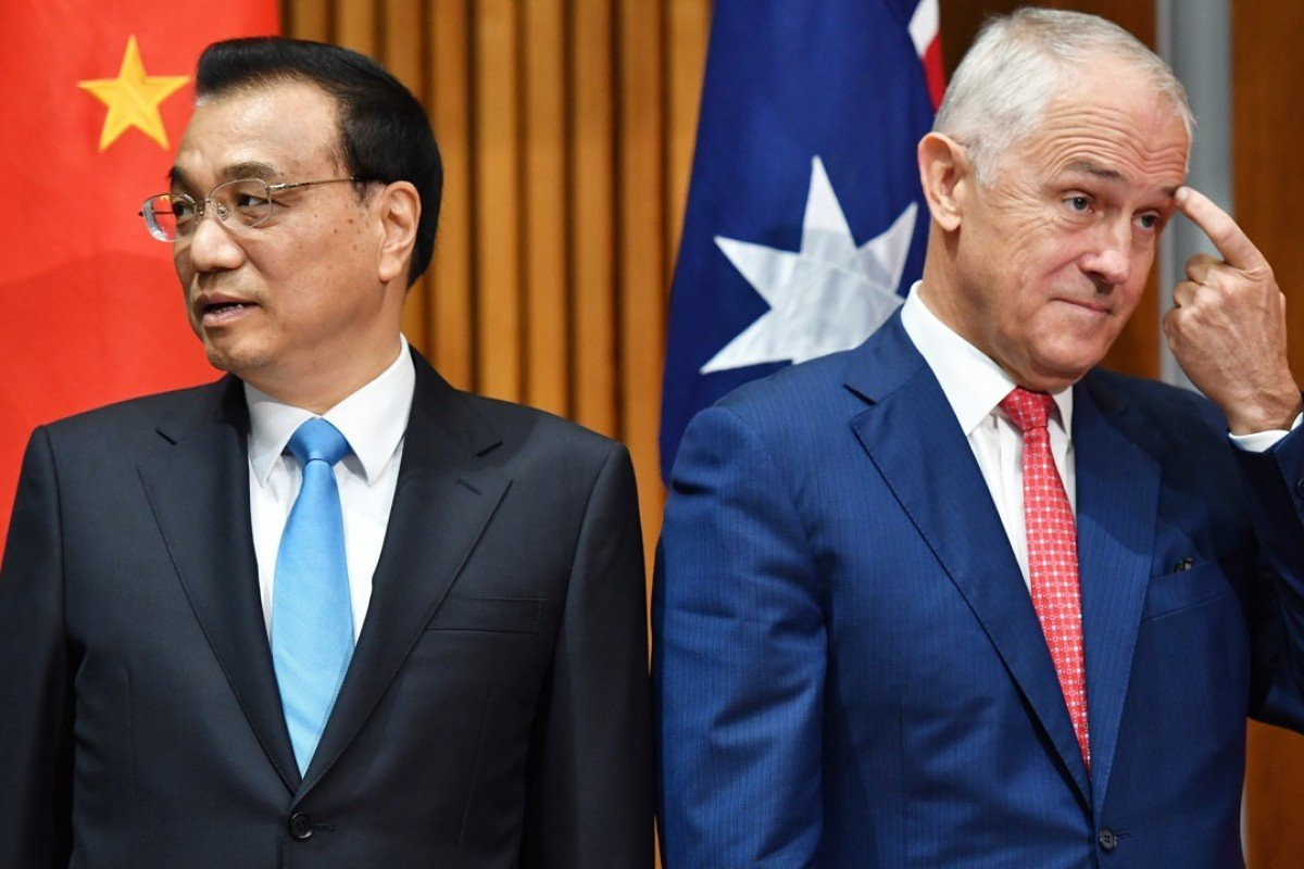 Premier of the State Council of the People's Republic of China Li Keqiang and Prime Minister of Australia Malcolm Turnbull attend a signing ceremony in Canberra, Australia. Photo: EPA