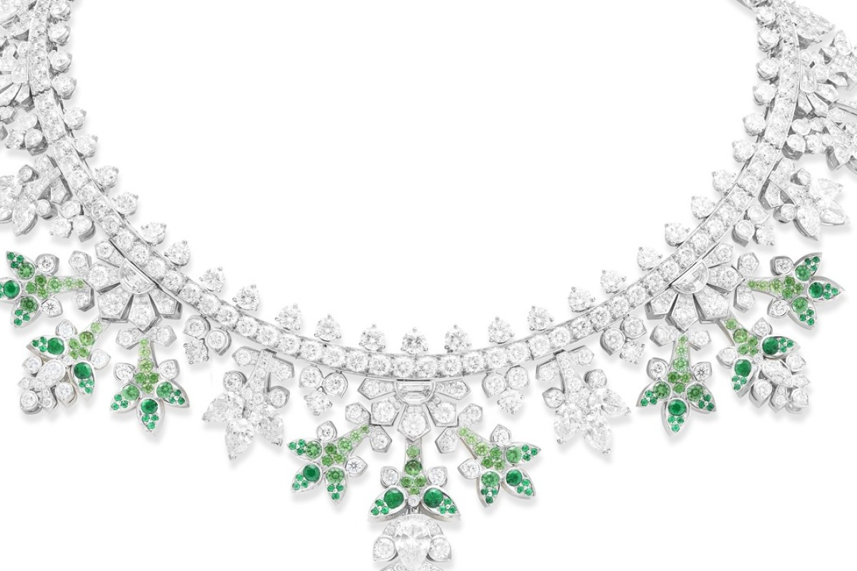 Van Cleef & Arpels. The Perce-Neige necklace, with a detachable clip, is in white gold and adorned with round, pear-shaped and half-moon diamonds, round emeralds and tsavorite garnets, including a 1.1ct pear-shaped diamond and a 1.1ct round diamond. Price on request