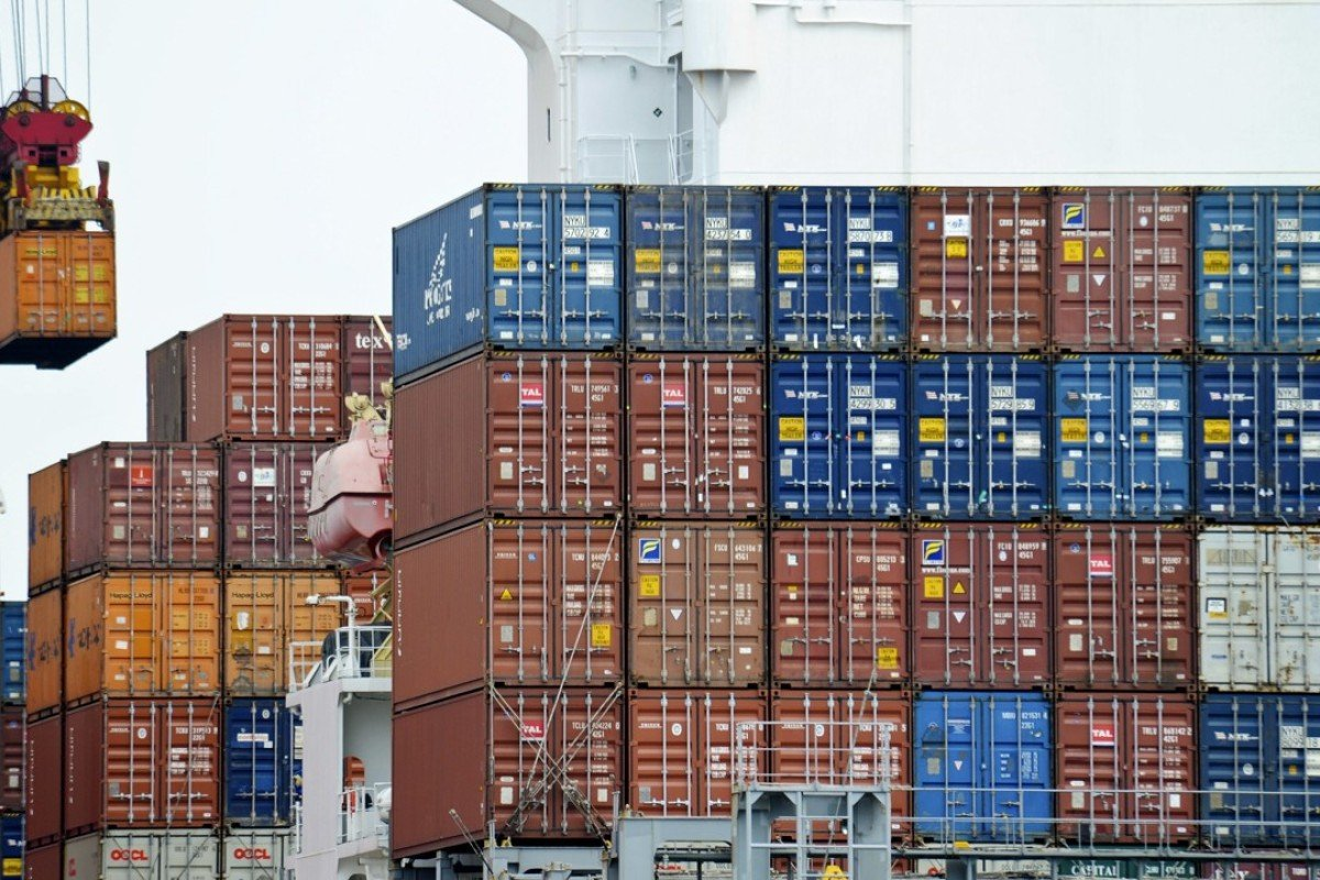 A container is loaded onto a cargo ship at the Tianjin port in China. The US government owes China US$1.2 trillion