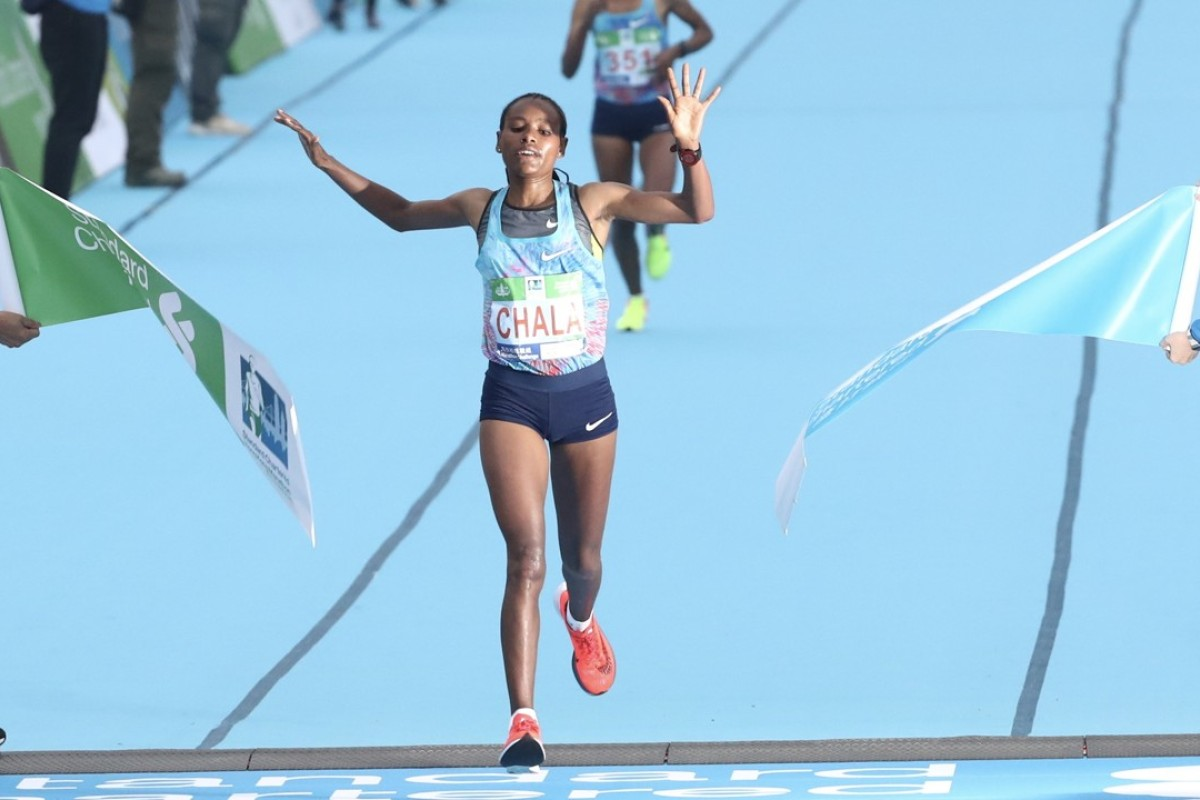 Gulume Tollesa Chala crosses the finish line to win the women's Hong Kong Marathon. Photo: Nora Tam