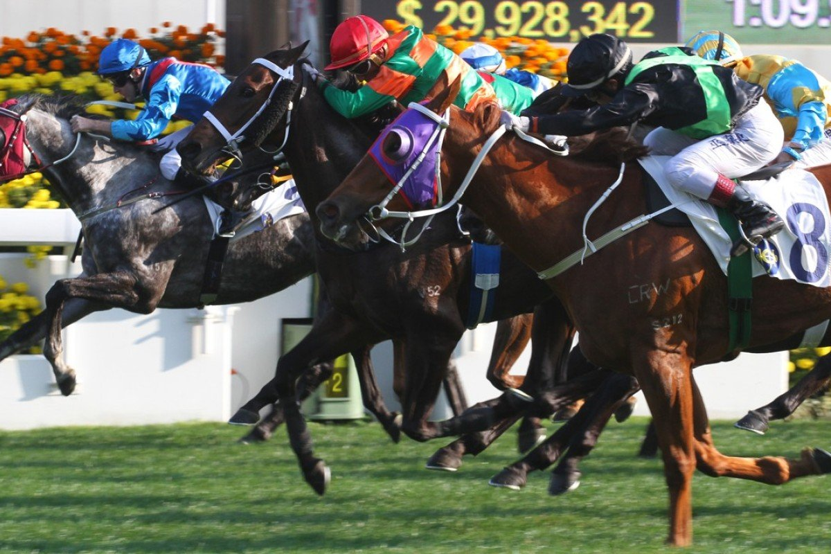 Douglas Whyte (green and orange silks) lifts Verbinsky to a narrow victory at Sha Tin on Sunday. Photos: Kenneth Chan