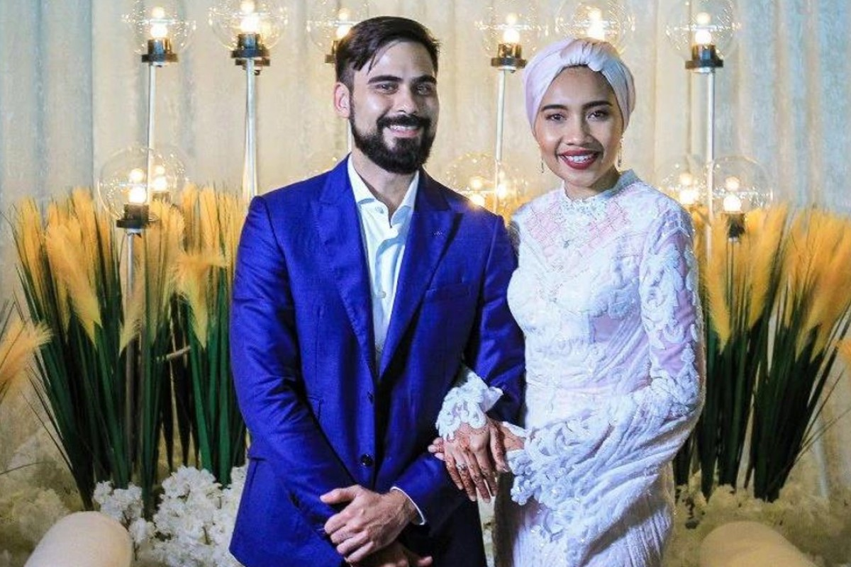 Newly married Malaysian singer-songwriter Yuna (right) with her husband Adam Yousof Sinclair. Photo: Asyraf Hamzah