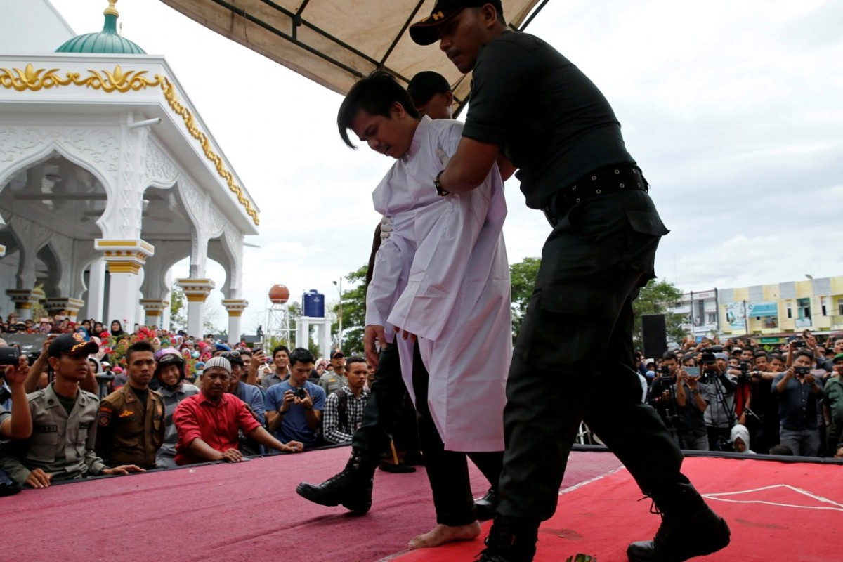 An Indonesian man is publicly caned for having gay sex. Photo: Reuters