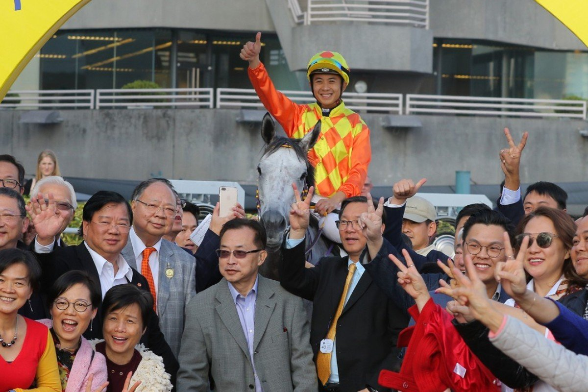 Derek Leung celebrates with owners after winning a Class Two last month on Pingwu Spark. Photos: Kenneth Chan