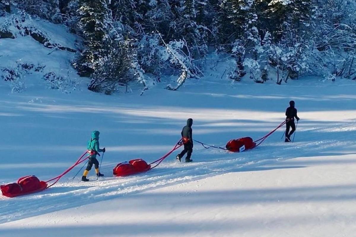 Steve Lo, Gary Leung and Inez Leong drag their sleds across the Yukon. Photo: Handout