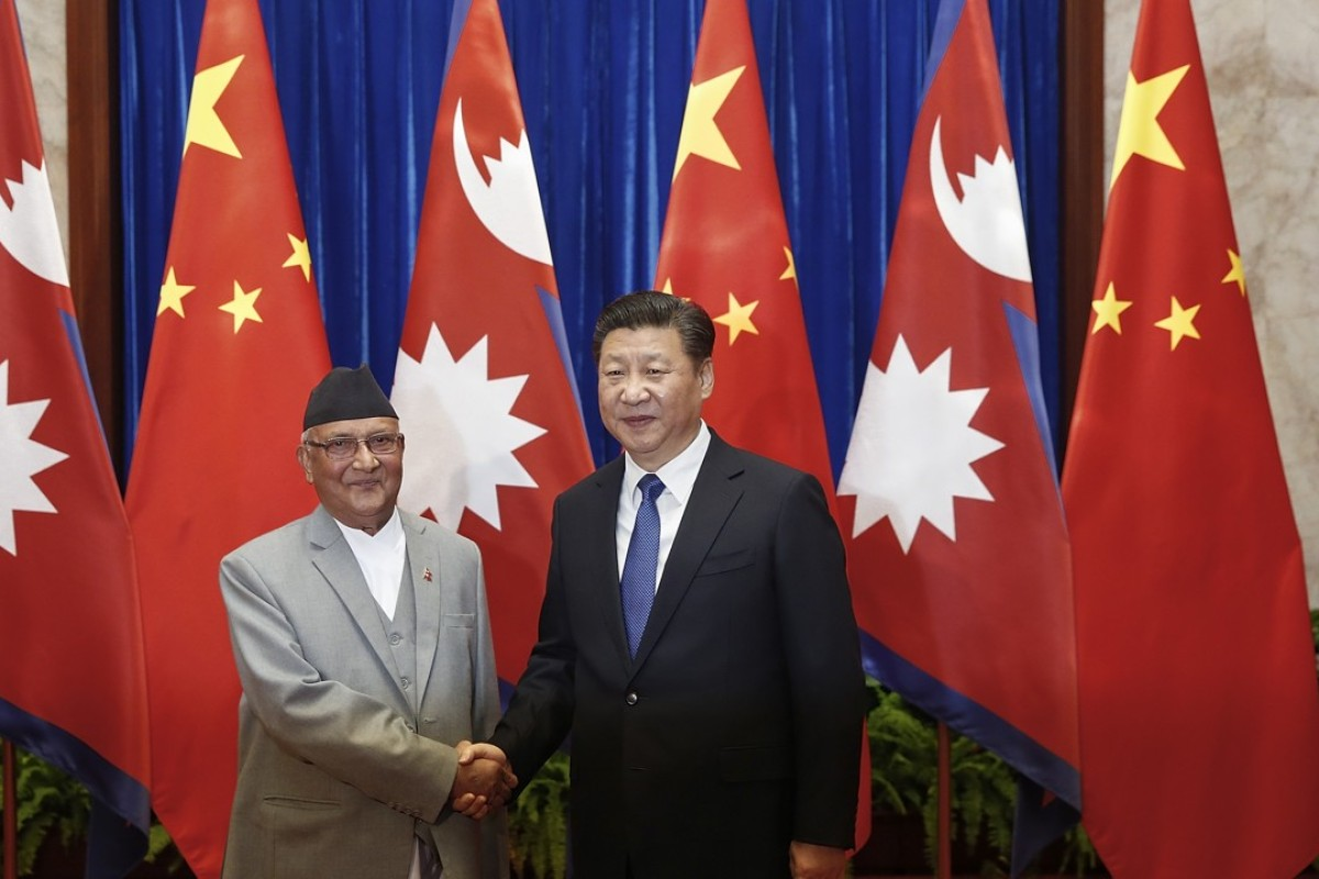 President Xi Jinping and new Nepalese Prime Minister Khadga Prasad Sharma Oli. Photo: AFP