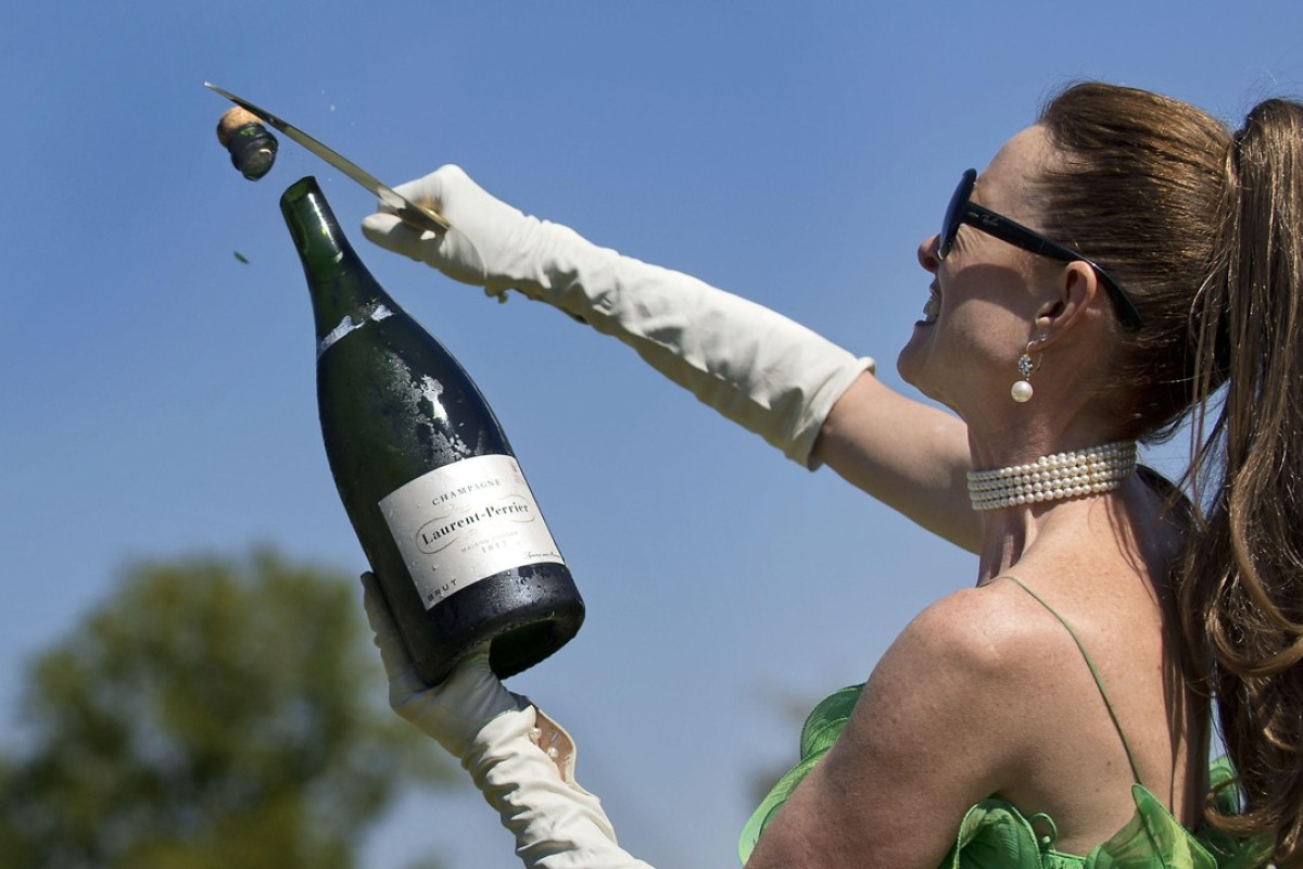 Using a technique known as sabrage, sommelier Catherine Fallis opens a bottle of champagne with a blade. Pictures: Alamy