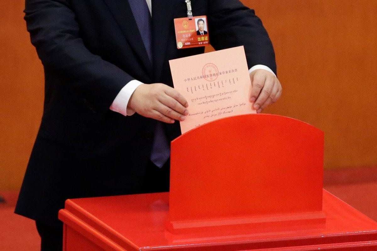 Chinese President Xi Jinping drops his ballot during a vote on a constitutional amendment lifting presidential term limits, at the third plenary session of the National People's Congress at the Great Hall of the People in Beijing. Photo: Reuters