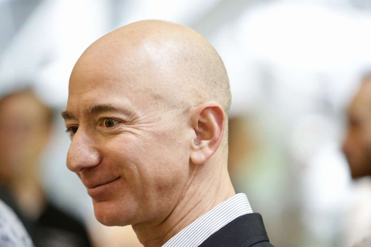Jeff Bezos, CEO of Amazon, tours the facility at the grand opening of the Amazon Spheres in Seattle, Washington, in January. Bezos is officially the richest person on the planet thanks to the success of Amazon. Photo: AFP