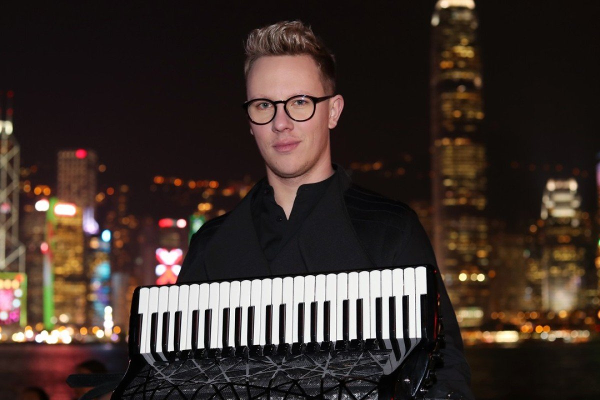 Martynas Levickis, an accordion player, poses for a portrait in Tsim Sha Tsui. Picture: K. Y. Cheng