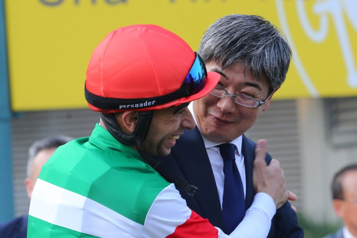 Joao Moreira celebrates with trainer Noriyuki Hori after winning the QE II Cup with Neorealism. Photos: Kenneth Chan