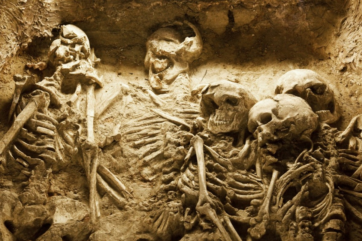 The skeletons of a family in an ancient sacrifice pit in China.