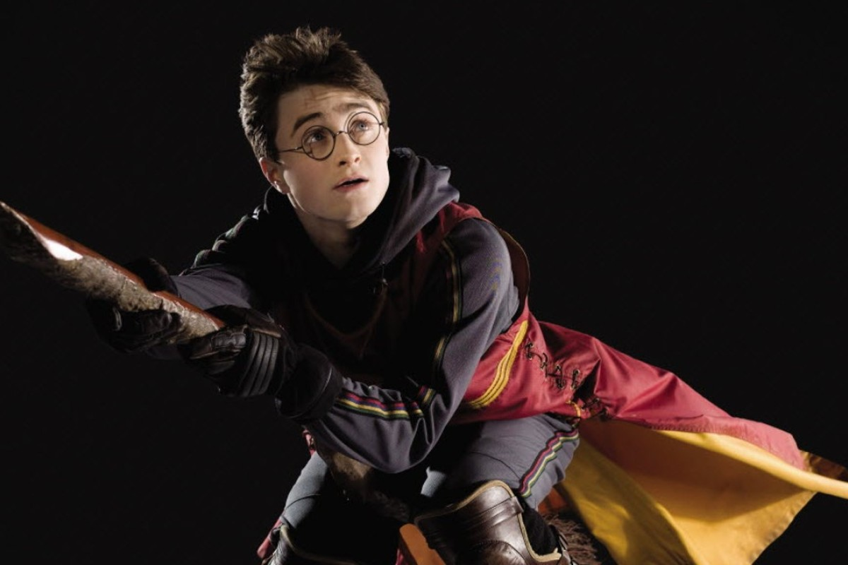 Daniel Radcliffe as Harry Potter on a broomstick.