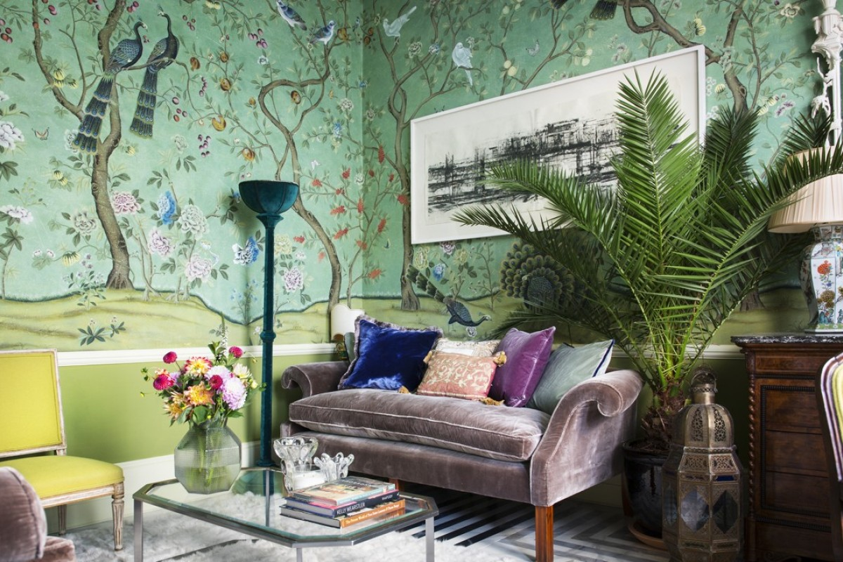 The lounge wallpaper, St Laurent, was created after Yves Saint Laurent's wallpaper in his home in Paris. The velvet couch is also from de Gournay. The marble floor is custom made. 'Nothing is fragile, a glass of whine or a dog can end up in the couch without problem,' says Hannah Gurney of de Gournay.