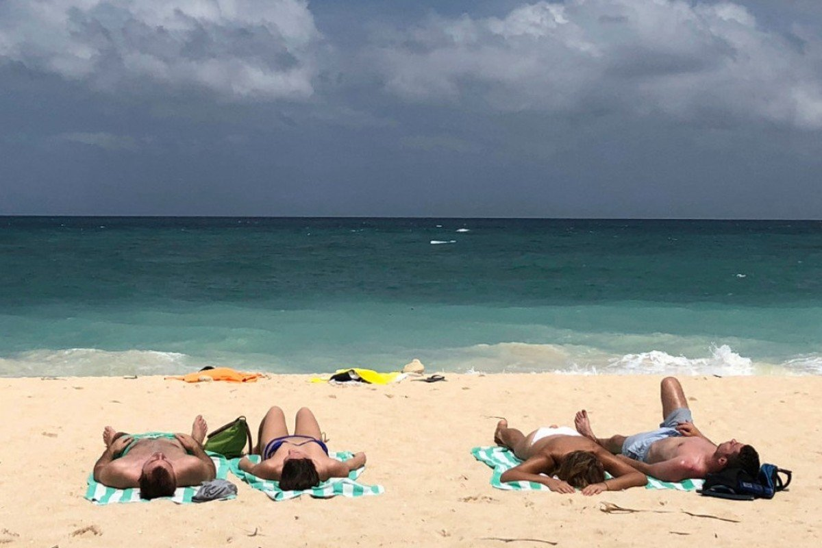 Tourists sunbathe on a beach on Boracay in the Philippines, in March 2018. Picture: AP